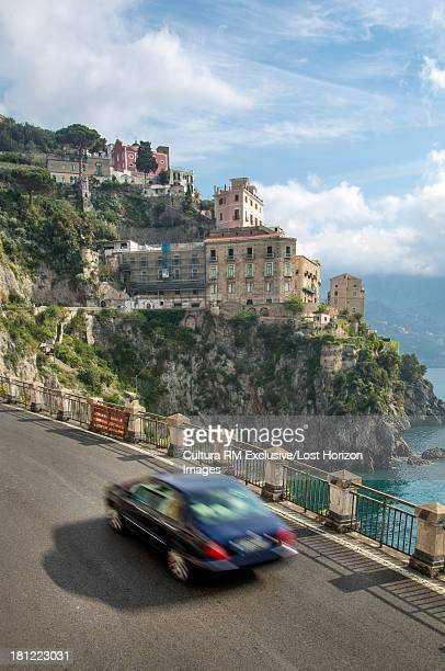 Car on the Amalfi Coast road near the village of Atrani, Campania, Italy