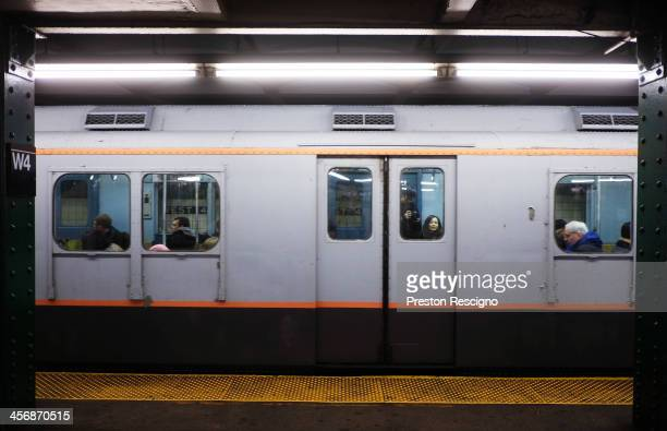A car on the Metropolitan Transit Authority 'Nostalgia' vintage subway train sits in the West 4th street station on December 15 2013 in New York City...