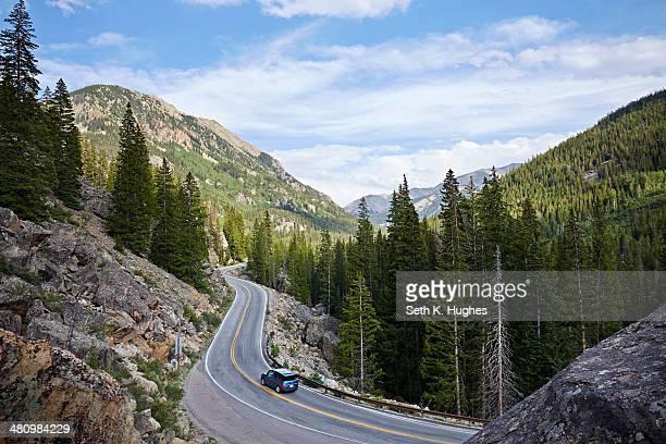 Car on winding highway, Aspen, Colorado, USA