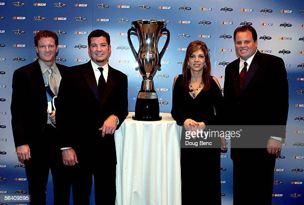 Car owner Dale Earnhardt Jr driver Martin Truex Jr car owner Teresa Earnhardt and crew chief Kevin Manion pose with the championship trophy after the...