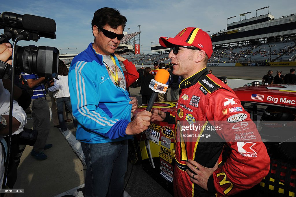 Car owner Michael Waltrip interviews Jamie McMurray, driver of the #1 McDonald's Chevrolet, on the grid during qualifying for the NASCAR Sprint Cup Series Toyota Owners 400 at Richmond International Raceway on April 26, 2013 in Richmond, Virginia.