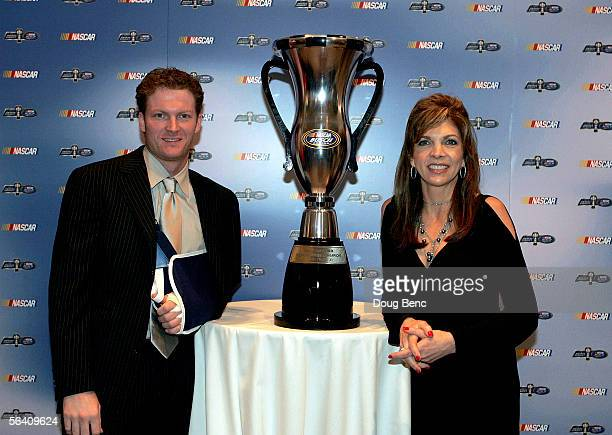 Car owners Dale Earnhardt Jr and Teresa Earnhardt pose with the championship trophy after the NASCAR Busch Series Banquet at the Portofino Bay Hotel...