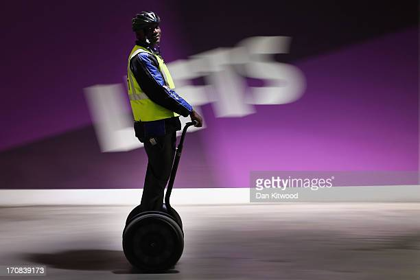 Car park attendent Mmfaniseni Debe 23 poses for a picture on his segway on June 18 2013 in Johannesburg South Africa Speaking of Nelson Mandela Mr...