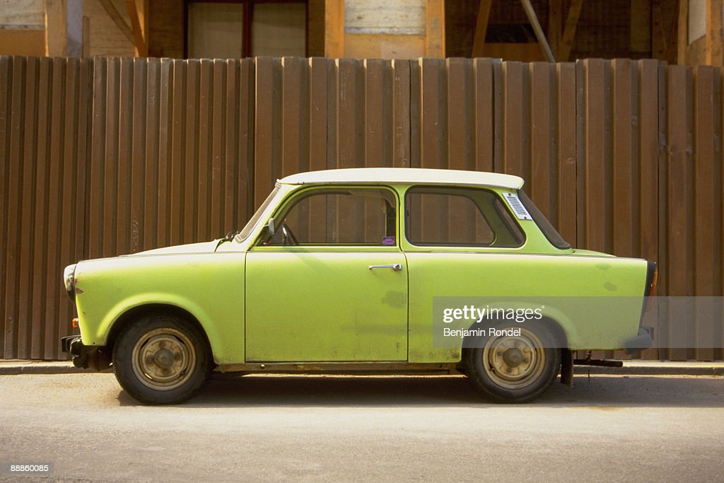 Car parked in front of fence : Stock Photo