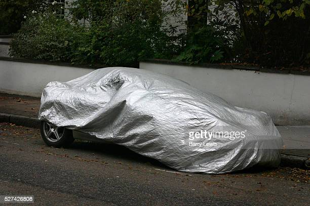 Car parked on a London street covered in protective wrapping to protect it against theft and bad weather