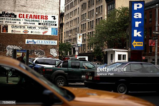 A car passes a parking lot July 13 2007 in auto congested New York City While real estate values fall in many parts of America in New York prices...
