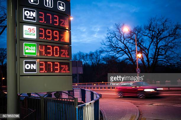 A car passes a petrol station just a few meters behind the border between Poland and Germany on January 31 2016 in Zgorzelec Many german people tank...
