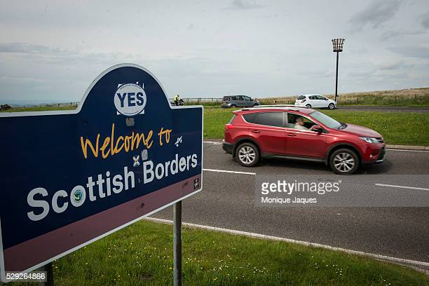 A car passes a sign welcoming visitors to the Scottish Border territories The sign has been marked by a YES sticker which is the slogan of the YES...
