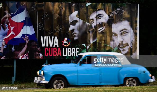 A car passes by a billboard reading 'Long Live Free Cuba' at the Revolution Square in Havana on November 27 2016 Cuban revolutionary icon Fidel...