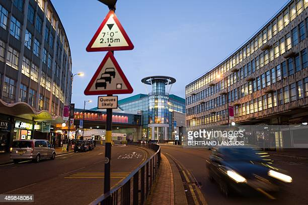A car passes by the Bullring commercial centre in Birmingham on September 21 2015 AFP PHOTO / BERTRAND LANGLOIS