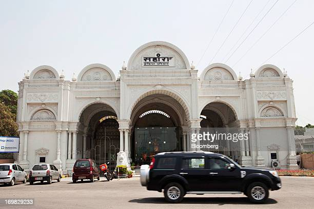 A car passes by the entrance of Sahara City the private residence and workplace of Sahara Group Chairman Subrata Roy in Lucknow India on Monday May 6...