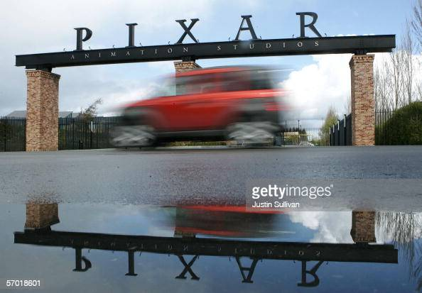 A car passes by the main gate to Pixar Animation Studios March 7 2006 in Emeryville California Pixar is expected to show a fourthquarter profit when...