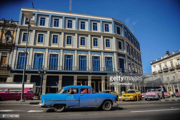 A car passes by the Telegrafo Hotel in Havana on November 8 2017 Tighter restrictions on US travellers to Cuba will go into effect on Thursday...
