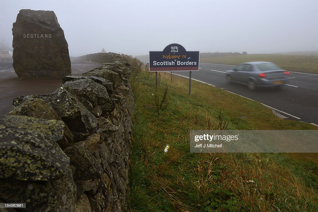 A car passes one of the marker stones situated at Carter Bar view point where the A68 crosses from Scotland into England on October 22, 2012 in Carter Bar, Scotland. Last week Scottish First Minister Alex Salmond met with British Prime Minister David Cameron and agreed on details for a Scottish independence referendum to be held in the autumn of 2014, asking a single yes or no question on whether the country should become independent.