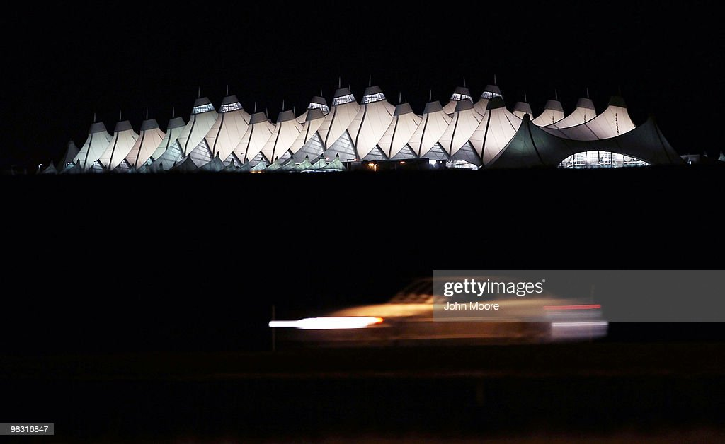 A car passes outside the main terminal of the Denver International Airport on April 7 2010 in Denver Colorado In what was suspected to be a possible...