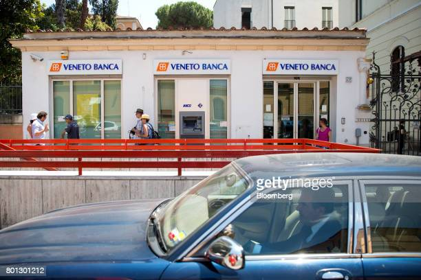 A car passes past a Veneto Banca SpA bank branch in Rome Italy on Monday June 26 2017 Italy orchestrated its biggest bank rescue on record committing...