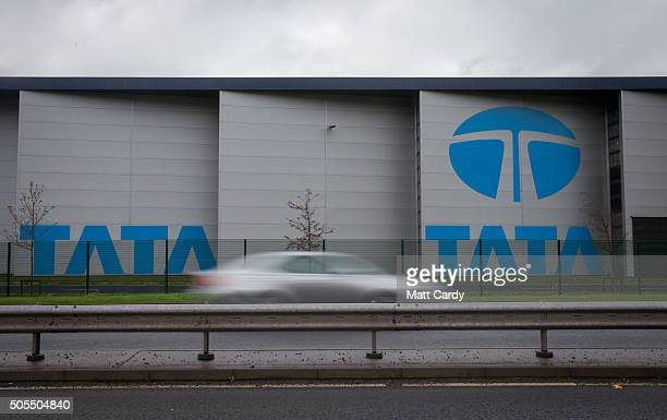 A car passes the company logo displayed at the Tata steelworks on January 18 2016 in Port Talbot Wales Tata Steel has confirmed today that it plans...