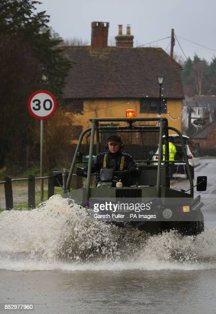 A car passes through a flooded road in Yalding Kent as the river levels rise around the village and more heavy rain sweeps across the country