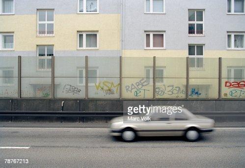 A car passing an apartment building