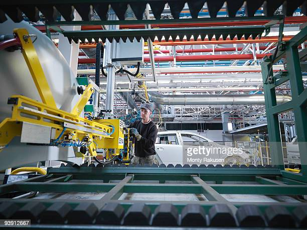 Car Plant Worker With Machinery