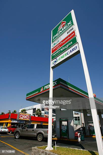 Car pull in and out of a Pemex gas station on June 27 2008 in Tijuana Mexico With the cost of gasoline in California around $460 per gallon many...