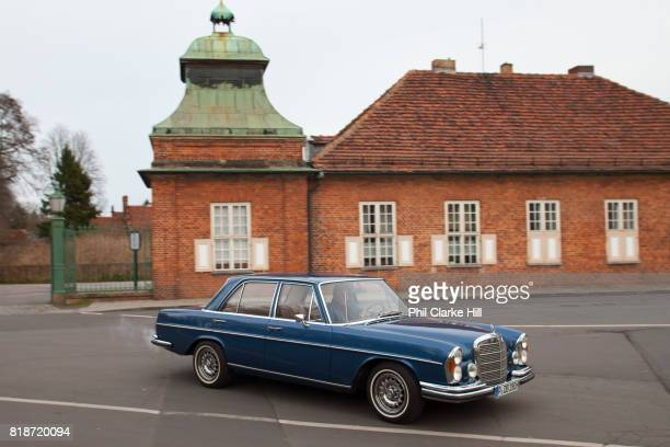A car pulling out of the Marmorpalais Gardens known as the Neuer Gardens The Palace was designed by Carl von Gontard and Carl Gotthard and is in the...