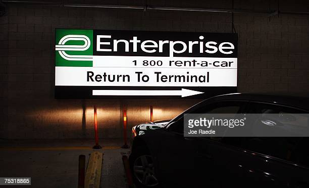 A car pulls out of the Enterprise car rental lot at the Fort Lauderdale/Hollywood International airport July 10 2007 in Fort Lauderdale Florida...