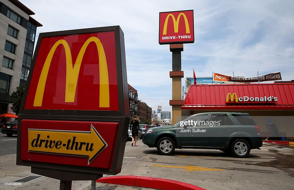 A car pulls out of the parking lot at a McDonald's restaurant on July 22 2013 in San Francisco California McDonald's stock slipped in Monday trading...