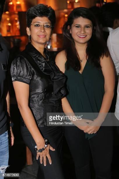 Car racer Bani Yadav with Harshita Mann during launch of Restaurant Raise The Bar at Clarens Hotel on November 16 2017 in Gurgaon India