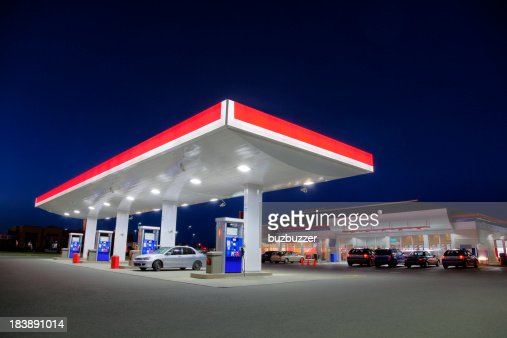 Car Refueling at Gas Station during the Night