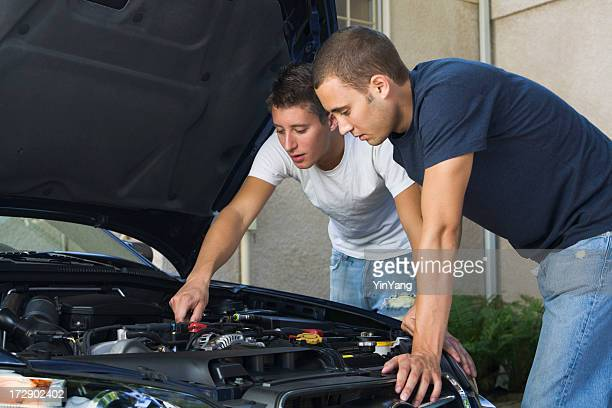 Car Repair and Engine Maintenance, Men Working Examining Under Hood