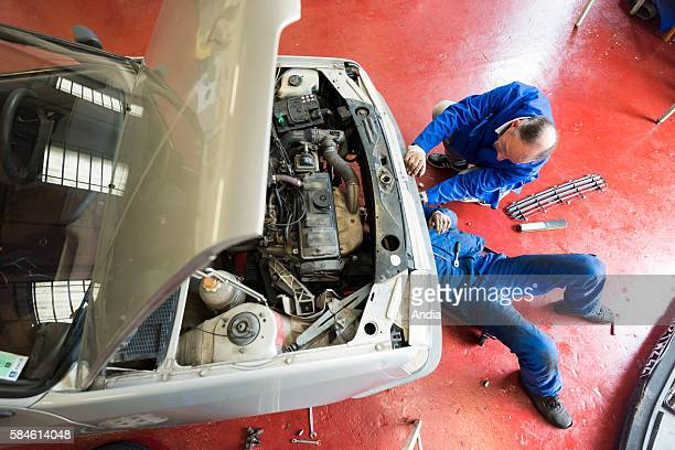 Car repairer auto industry Mechanic fixing a car engine in a workshop