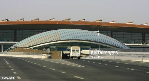 A car runs to the new terminal building T3 at the Beijing Capital International Airport on February 26 2008 in Beijing China T3 is reported as the...