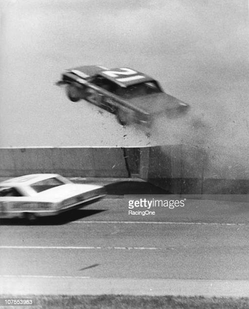 A car sails over the wall during a stunt performed as a scene for the stock car racing movie Red Line 7000 Stunts like this one and actual race...