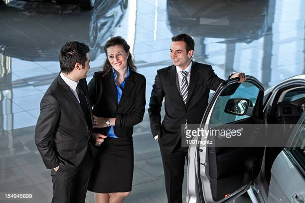 Car Salesman and Couple Buyer