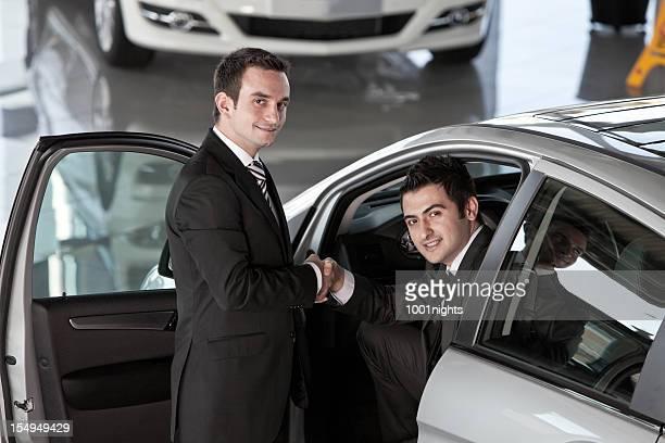 Car Salesman and Man Buyer