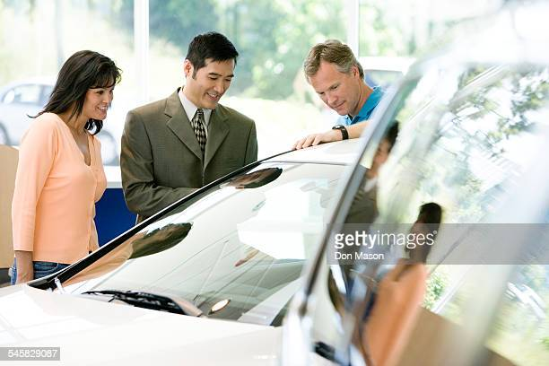 Car Salesman Assisting Customers