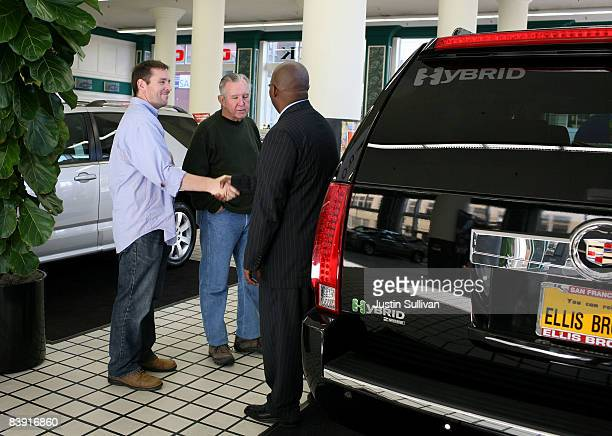 Car salesman Bobby Sisk Jr tries to sell a brand new Cadillac Escalade Hybrid to Chuck Garner and his son Jeff Garner at Ellis Brooks Chevrolet...