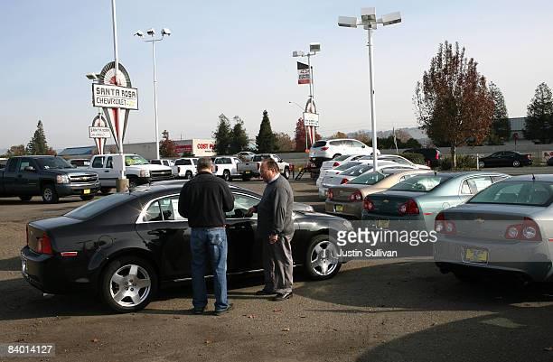 A car salesman tries to make a sale at Santa Rosa Chevrolet December 12 2008 in Santa Rosa California Auto dealerships continue to see a sharp...