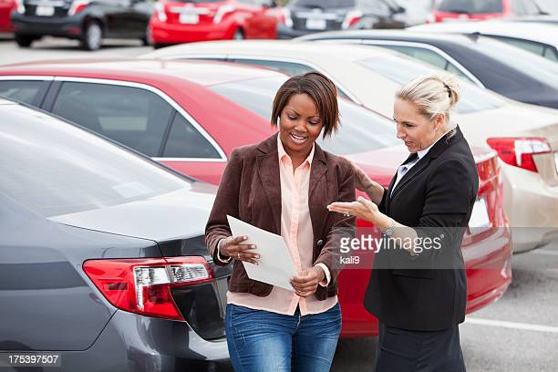 Car salesperson with a customer