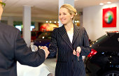 Car saleswoman selling car