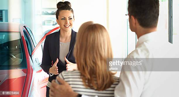 Car saleswoman trying to make a sale.