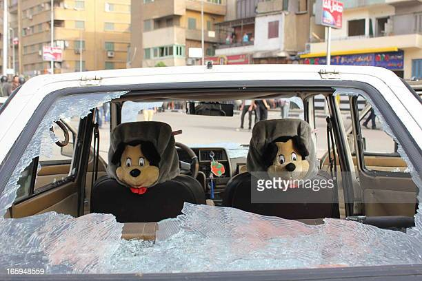 Car seat covers depicting the cartoon character Mickey Mouse are seen through a smashed window during sectarian clashes outside the Egyptian Coptic...