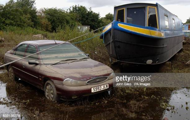 A car side by side with a boat in Toll Bar near Doncaster which was hit by heavy flooding