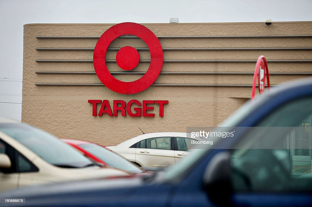 Car sit parked in front of a Target Corp. store in Peru, Illinois, U.S., on Thursday, Feb. 7, 2013. Target Corp. led U.S. retailers to the biggest monthly same-store sales gain in more than a year as shoppers snapped up discounted merchandise chains were clearing out after the holidays. Photographer: Daniel Acker/Bloomberg via Getty Images