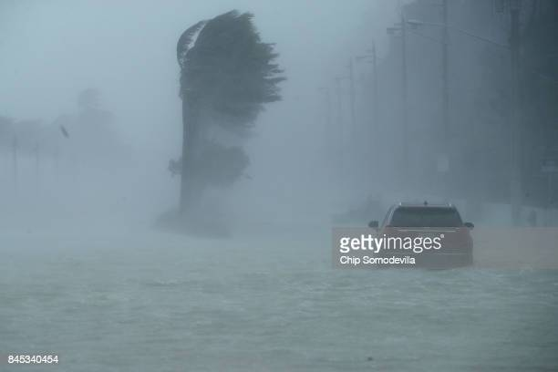 A car sits abandoned in storm surge along North Fort Lauderdale Beach Boulevard as Hurricane Irma hits the southern part of the state September 10...