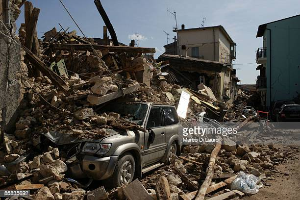 A car sits covered in rubble on April 7 2009 in Onna a village near L'Aquila Italy On April 6 2009 the 63 magnitude earthquake tore through central...