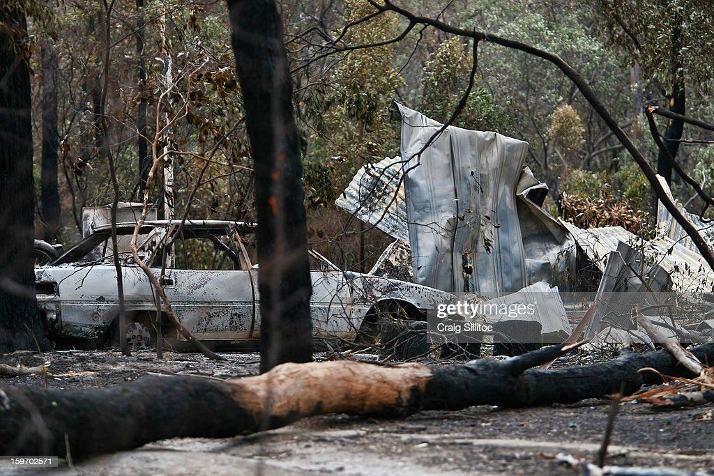 A car sits damaged from a fire in the town of Seaton on January 19, 2013 in Melbourne, Australia. Bushfires in Victoria have claimed one life and destroyed several houses. Record heat continues to create extreme fire conditions throughout Australia.