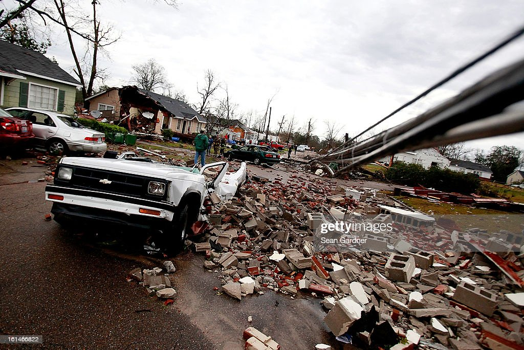 A car sits destroyed by fallen debris after a tornado touched down yesterday evening on February 11, 2013 in Hattiesburg, Mississippi. Hundreds of homes were destroyed and over sixty people injured when the tornado ripped through the town.