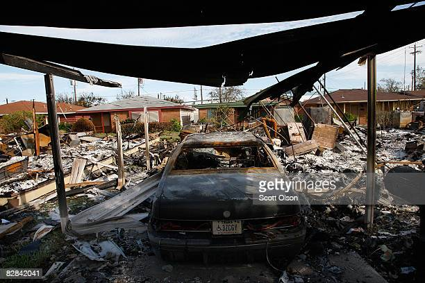 A car sits in a burned out garage the result of one of the many fires caused by Hurricane Ike September 16 2008 in Galveston Texas City officials...